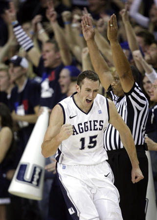 Mitch Bruneel celebrates after hitting a 3-pointer in his first Utah State game